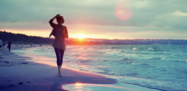 Woman walking in the sand under the sunset HD picture