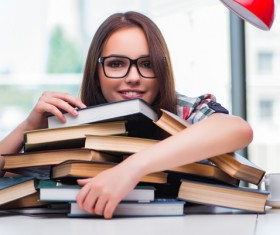 Young female student holding books HD picture