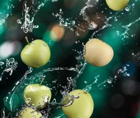 Apples and splashing water Stock Photo