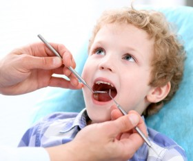 Check the teeth of the child Stock Photo