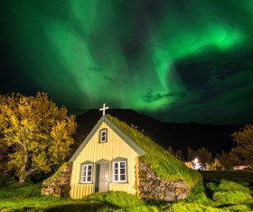 Churches and midnight aurora