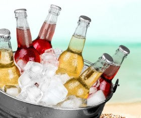 Ice cubes and beer in buckets Stock Photo