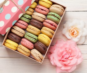 Macaron and flowers on the table Stock Photo