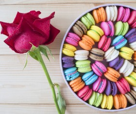 Macaron in the box with flowers Stock Photo