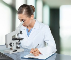 Medical laboratory woman working with A microscope 01