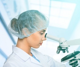 Medical laboratory woman working with A microscope 02