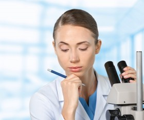 Medical laboratory woman working with A microscope 04