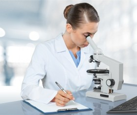 Medical laboratory woman working with A microscope 06