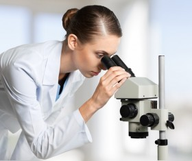 Medical laboratory woman working with A microscope 09