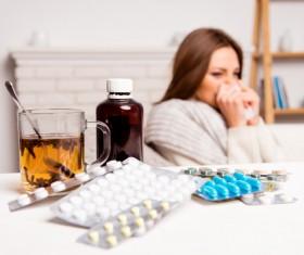 Sick woman with desktop medicine Stock Photo 03