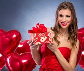 Smiling girl with a Valentines gift HD picture 02