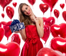 Smiling girl with a Valentines gift HD picture 16