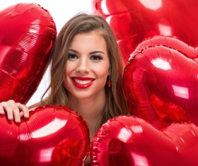 Smiling girl with a Valentines gift HD picture 17
