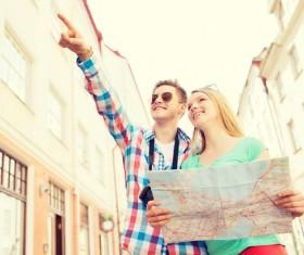 Tourists and city maps Stock Photo