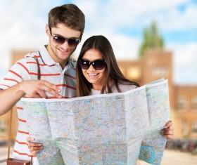 Tourists view the city map Stock Photo