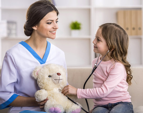 A little girl playing with a pediatrician Stock Photo 02