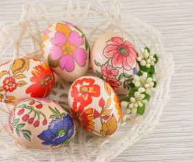 Baskets decorated eggs of different flowers Stock Photo