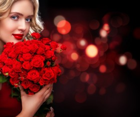 Beautiful blonde woman holding bouquet of red roses HD picture 02
