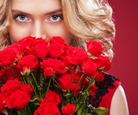 Beautiful blonde woman holding bouquet of red roses HD picture 03