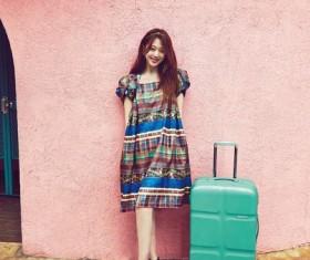Beautiful girl with traveler Stock Photo