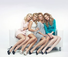 Blond cute ladies on the couch Stock Photo 02
