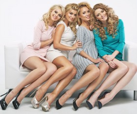 Blond cute ladies on the couch Stock Photo 03