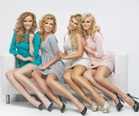 Blond cute ladies on the couch Stock Photo 04