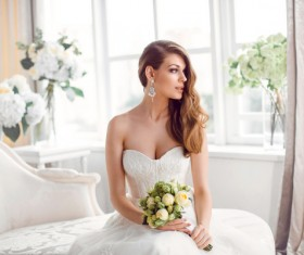 Bride in beautiful dress sitting resting on sofa Stock Photo 01
