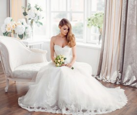 Bride in beautiful dress sitting resting on sofa Stock Photo 02