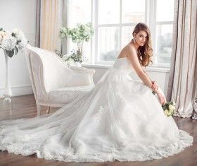Bride in beautiful dress sitting resting on sofa Stock Photo 04