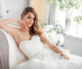 Bride in beautiful dress sitting resting on sofa Stock Photo 05