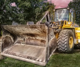 Bulldozer parked beside the forest Stock Photo