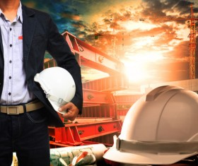 Civil engineer working table with safety helmet Stock Photo 01