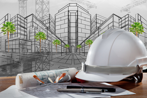Civil Engineer Working Table With Safety Helmet Stock