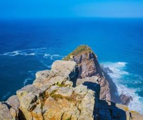 Coastal rocks and the vastness of the sea Stock Photo