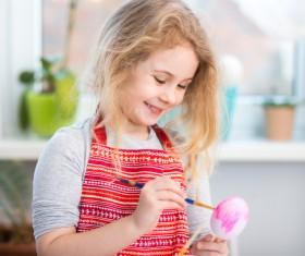 Do Easter eggs little girl Stock Photo 01
