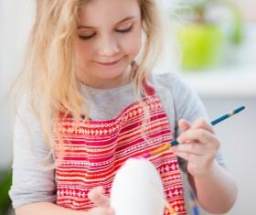 Do Easter eggs little girl Stock Photo 02