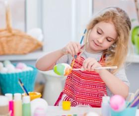 Do Easter eggs little girl Stock Photo 03