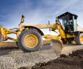 Flat road bulldozer Stock Photo