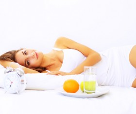 Food and bed smiling girl Stock Photo
