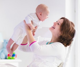 Funny baby laughing mother Stock Photo