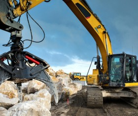Grab the excavator of the stone Stock Photo