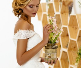 Hand holding a flower pot of dignified beauty woman Stock Photo 02