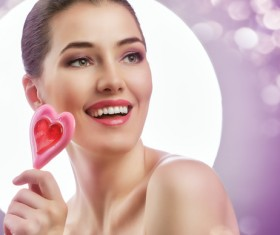 Heart-shaped lollipop girl Stock Photo