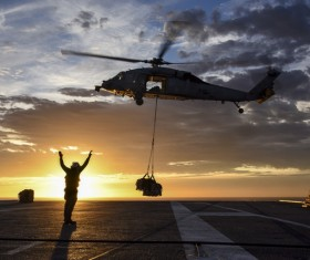 Helicopter unloading Stock Photo
