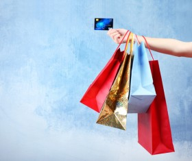 Holding a shopping bag with a bank card for a woman Stock Photo 02