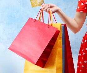 Holding a shopping bag with a bank card for a woman Stock Photo 03