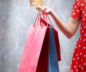 Holding a shopping bag with a bank card for a woman Stock Photo 04