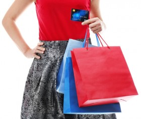 Holding a shopping bag with a bank card for a woman Stock Photo 05