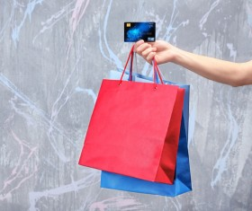 Holding a shopping bag with a bank card for a woman Stock Photo 06